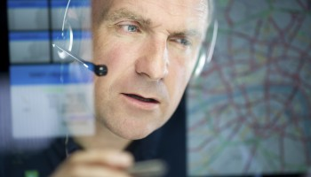 mature logistics call handler planning a route  ** graphics interface self generated **